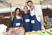 Ally Brooke, Emma Roberts and David Arquette attend the Celebrity friends of Feeding America give back at the Para Los Niños Felices Fiestas to celebrate the holidays and raise awareness around the issue of hunger at Para Los Ninos Gratts Primary Center on December 14, 2019 in Los Angeles, California.