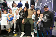 NFL player Adrian Peterson of the Minnesota Vikings and his wife Ashley sit with patients and their family at the Starkey Hearing Foundation hearing mission during Super Bowl weekend 2016 at San Francisco State University on February 6, 2016 in San Francisco, California.