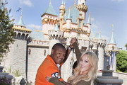 """In this handout image provided by Walt Disney Studios, Actor Kyle Massey and professional dancer Lacey Schwimmer took the day off from rehearsing for the season premiere of """"Dancing with the Stars"""" to celebrate their new partnership at Disneyland on September 9, 2010.  Massey, Schwimmer and 11 other couples will dance for the first time live on national television on Monday September 20 on ABC."""