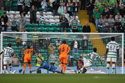 Sung Yeung Ki of Celtic puts the ball past Samir Handanovic of Udinese to score during the Europa League Group I match between Celtic and Udinese at Celtic Park on September 29, 2011 in Glasgow, United Kingdom.