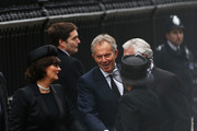 Former Prime Ministers Tony Blair (C) and John Major with their wives Norma Major and Cherie Blair (L) attend the Ceremonial funeral of former British Prime Minister Baroness Thatcher at St Paul's Cathedral on April 17, 2013 in London, England. Dignitaries from around the world today join Queen Elizabeth II and Prince Philip, Duke of Edinburgh as the United Kingdom pays tribute to former Prime Minister Baroness Thatcher during a Ceremonial funeral with military honours at St Paul's Cathedral. Lady Thatcher, who died last week, was the first British female Prime Minister and served from 1979 to 1990.