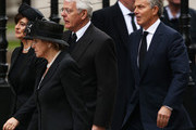 Former Prime Ministers John Major (C) and Tony Blair with their wives Norma Major and Cherie Blair (L) attend the Ceremonial funeral of former British Prime Minister Baroness Thatcher at St Paul's Cathedral on April 17, 2013 in London, England. Dignitaries from around the world today join Queen Elizabeth II and Prince Philip, Duke of Edinburgh as the United Kingdom pays tribute to former Prime Minister Baroness Thatcher during a Ceremonial funeral with military honours at St Paul's Cathedral. Lady Thatcher, who died last week, was the first British female Prime Minister and served from 1979 to 1990.