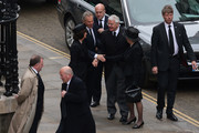 Former Prime Ministers John Major (C) and Tony Blair with their wives Norma Major and Cherie Blair (3rd L) attend the Ceremonial funeral of former British Prime Minister Baroness Thatcher at St Paul's Cathedral on April 17, 2013 in London, England. Dignitaries from around the world today join Queen Elizabeth II and Prince Philip, Duke of Edinburgh as the United Kingdom pays tribute to former Prime Minister Baroness Thatcher during a Ceremonial funeral with military honours at St Paul's Cathedral. Lady Thatcher, who died last week, was the first British female Prime Minister and served from 1979 to 1990.