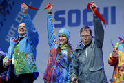 Gilbert Felli (R), IOC Executive Director for the Olympic Games, Yelena Isinbayeva (C), mayor of the Olympic Village and Dmitry Chernyshenko, Sochi 2014 Olympics President and CEO take part in a ribbon cutting ceremony to open the coastal Olympic Village at the 2014 Winter Olympics January 30, 2014 in Sochi, Russia. The Olympics are set to open February 7, and run through the 23.