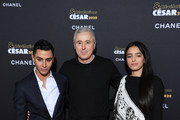 """(L-R) Djanis Bouzyani, Robin Campillo and Hafsia Herzi attend the """"""""Cesar - Revelations 2020"""" Photocall at Petit Palais on January 13, 2020 in Paris, France."""
