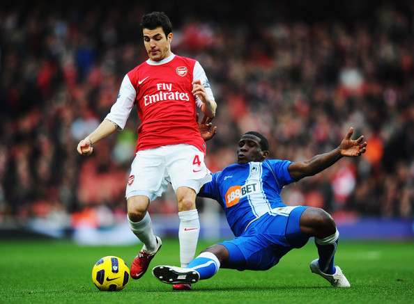 Cesc Fabregas Cesc Fabregas (L) of Arsenal is tackled by Hendry Thomas (R) of Wigan Athletic during the Barclays Premier League match between Arsenal and Wigan Athletic at the Emirates Stadium on January 22, 2011 in London, England.