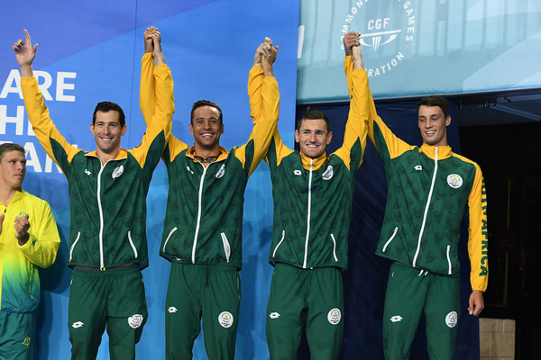 Swimming - Commonwealth Games Day 6 [team,uniform,crew,player,team sport,sports uniform,medley relay final,bronze medalists,calvyn justus,cameron van der burgh,chad le clos,bradley tandy,south africa,mens 4,commonwealth games,medal ceremony]