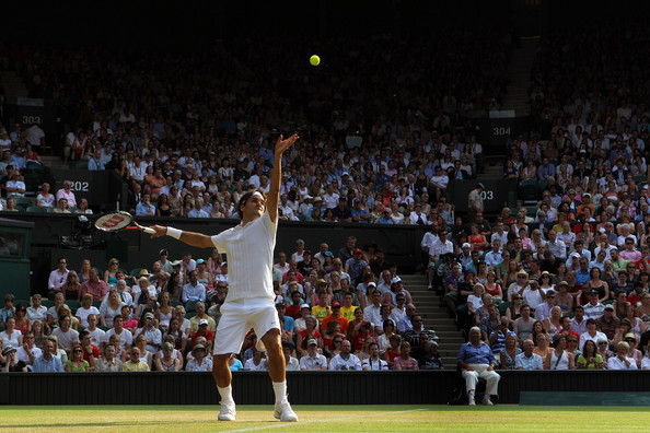 Roger Federer of Switzerland serves during his match against Arnaud Clement of France on Day Five of the Wimbledon Lawn Tennis Championships at the All England Lawn Tennis and Croquet Club on June 25, 2010 in London, England.