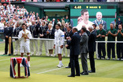 Prince Edward, Duke of Kent (3rd from R), Chairman of the All England Lawn Tennis Club Philip Brook (2nd from R) and LTA president Peter Bretherton (R) present Novak Djokovic of Serbia  (L) and Rafael Nadal of Spain (2nd from L) their trophies after their final round Gentlemans' match on Day Thirteen of the Wimbledon Lawn Tennis Championships at the All England Lawn Tennis and Croquet Club on July 3, 2011 in London, England.