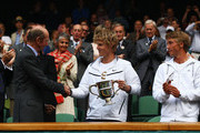 Prince Edward, Duke of Kent(L)  presents Luke Saville of Australia (C) and Liam Broady of Great Britain with their trophies after their final round boy's match against on Day Twelve of the Wimbledon Lawn Tennis Championships at the All England Lawn Tennis and Croquet Club on July 2, 2011 in London, England.