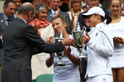 Prince Edward, Duke of Kent (L) presents Kveta Peschke of the Czech Republic (C) and Katarina Srebotnik of Slovenia  with their championship trophies after winning their final round Ladies' doubles match against  Sabine Lisicki of Germany and Samantha Stosur of Australia on Day Twelve of the Wimbledon Lawn Tennis Championships at the All England Lawn Tennis and Croquet Club on July 2, 2011 in London, England.
