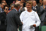 Prince Edward, Duke of Kent (L)  presents Liam Broady of Great Britain with his trophy after his final round boy's match against on Day Twelve of the Wimbledon Lawn Tennis Championships at the All England Lawn Tennis and Croquet Club on July 2, 2011 in London, England.