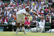 Juan Martin Del Potro of Argentina dives to volley the ball during the Gentlemen's Singles semi-final match against Novak Djokovic of Serbia on day eleven of the Wimbledon Lawn Tennis Championships at the All England Lawn Tennis and Croquet Club on July 5, 2013 in London, England.