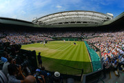 A general view of Centre Court as Juan Martin Del Potro of Argentina plays a shot through his legs during the Gentlemen's Singles semi-final match against Novak Djokovic of Serbia on day eleven of the Wimbledon Lawn Tennis Championships at the All England Lawn Tennis and Croquet Club on July 5, 2013 in London, England.