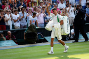 Novak Djokovic of Serbia waves to the crowd as he leaves Centre Court following his victory in the Gentlemen's Singles semi-final match against Juan Martin Del Potro of Argentina on day eleven of the Wimbledon Lawn Tennis Championships at the All England Lawn Tennis and Croquet Club on July 5, 2013 in London, England.