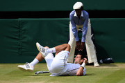 Novak Djokovic of Serbia falls to the ground during the Gentlemen's Singles semi-final match against Juan Martin Del Potro of Argentina on day eleven of the Wimbledon Lawn Tennis Championships at the All England Lawn Tennis and Croquet Club on July 5, 2013 in London, England.