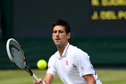 Novak Djokovic of Serbia plays a forehand during the Gentlemen's Singles semi-final match against Juan Martin Del Potro of Argentina on day eleven of the Wimbledon Lawn Tennis Championships at the All England Lawn Tennis and Croquet Club on July 5, 2013 in London, England.