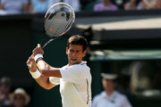 Novak Djokovic of Serbia plays a backhand during the Gentlemen's Singles semi-final match against Juan Martin Del Potro of Argentina on day eleven of the Wimbledon Lawn Tennis Championships at the All England Lawn Tennis and Croquet Club on July 5, 2013 in London, England.