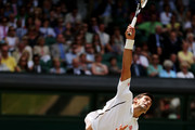 Novak Djokovic of Serbia serves during the Gentlemen's Singles semi-final match against Juan Martin Del Potro of Argentina on day eleven of the Wimbledon Lawn Tennis Championships at the All England Lawn Tennis and Croquet Club on July 5, 2013 in London, England.