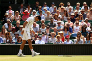 Novak Djokovic of Serbia picks himself up after slipping during the Gentlemen's Singles semi-final match against Juan Martin Del Potro of Argentina on day eleven of the Wimbledon Lawn Tennis Championships at the All England Lawn Tennis and Croquet Club on July 5, 2013 in London, England.