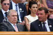 Prince Andrew, Duke of York sits next to AELTC Chairman Philip Brook during the Gentlemen's Singles semi-final match between Novak Djokovic of Serbia and Juan Martin Del Potro of Argentina on day eleven of the Wimbledon Lawn Tennis Championships at the All England Lawn Tennis and Croquet Club on July 5, 2013 in London, England.