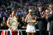 Marion Bartoli of France and Sabine Lisicki of Germany react as they hold their trophies following the presentation ceremony after their Ladies' Singles final match on day twelve of the Wimbledon Lawn Tennis Championships at the All England Lawn Tennis and Croquet Club on July 6, 2013 in London, England.