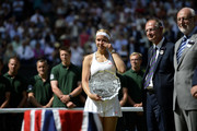 Sabine Lisicki of Germany reacts after receiving her runner-up trophy from Prince Edward, Duke of Kent on Centre Court after her Ladies' Singles final match against Marion Bartoli of France on day twelve of the Wimbledon Lawn Tennis Championships at the All England Lawn Tennis and Croquet Club on July 6, 2013 in London, England.