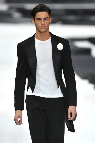 Model Baptiste Giabiconi walks the runway during the Chanel Ready to Wear Spring/Summer 2011 show during Paris Fashion Week at Grand Palais on October 5, 2010 in Paris, France.