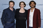 (L-R) Hugh Jackman, Sigourney Weaver, and Dev Patel attend a fan event for the film 'CHAPPIE' at Mall of Berlin on February 27, 2015 in Berlin, Germany.