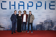 (L-R) Hugh Jackman, Sigourney Weaver, Dev Patel and Neill Blomkamp attend a fan event for the film 'CHAPPIE' at Mall of Berlin on February 27, 2015 in Berlin, Germany.