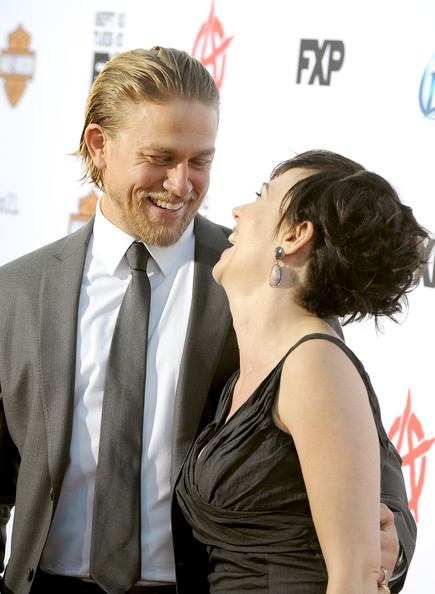 """Charlie Hunnam Actors Charlie Hunnam (L) and Maggie Siff attend the season 6 premiere of FX's """"Sons Of Anarchy"""" at Dolby Theatre on September 7, 2013 in Hollywood, California."""
