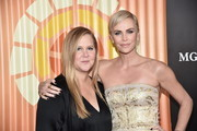 Amy Schumer and Charlize Theron attend the Africa Outreach Project Fundraiser hosted by Charlize Theron at The Africa Center on November 12, 2019 in New York City.