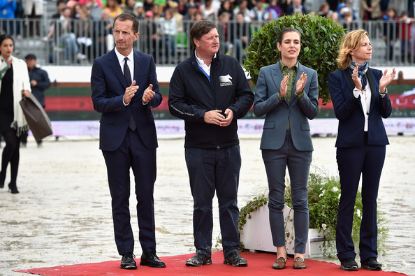 Charlotte Casiraghi (L-R) Robert Triefus, Jan Tops, Charlotte Casiraghi and Virginie Couperie-Eiffel attend the Paris Eiffel Jumping presented by Gucci at Champ-de-Mars on July 6, 2014 in Paris, France.