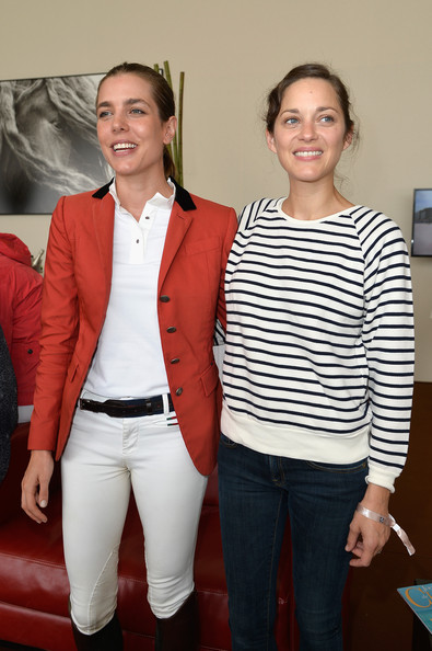 Charlotte Casiraghi (L-R) Charlotte Casiraghi and Marion Cotillard attend the Paris Eiffel Jumping presented by Gucci at Champ-de-Mars on July 4, 2014 in Paris, France.