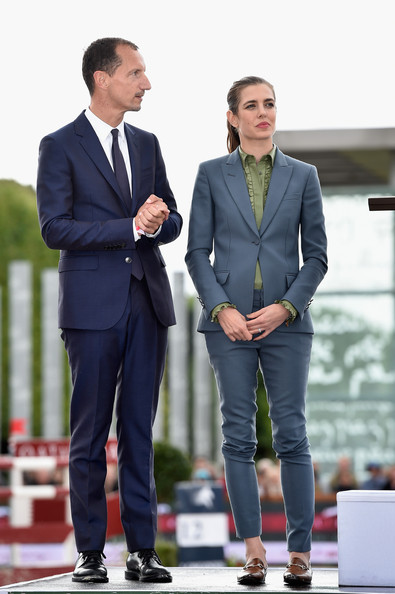 Charlotte Casiraghi (L-R) Robert Triefus and Charlotte Casiraghi attend the Paris Eiffel Jumping presented by Gucci at Champ-de-Mars on July 6, 2014 in Paris, France.