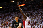 Frank Kaminsky III #44 of the Charlotte Hornets drives on Luol Deng #9 of the Miami Heat during Game Seven of the Eastern Conference Quarterfinals of the 2016 NBA Playoffs at American Airlines Arena on May 1, 2016 in Miami, Florida. NOTE TO USER: User expressly acknowledges and agrees that, by downloading and or using this photograph, User is consenting to the terms and conditions of the Getty Images License Agreement