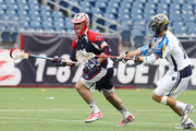 Kevin Drew #19 of the  Charlotte Hounds chases Rob Emery #4 of the Boston Cannons down the field during a game between the Charlotte Hounds and the Boston Cannons April 26, 2015 at Gillette Stadium in Foxboro, Massachusetts.