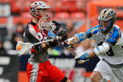 Drew Snider #23 of the Denver Outlaws takes a shot against Kevin Drew #19 of the Charlotte Hounds at Sports Authority Field at Mile High on May 3, 2015 in Denver, Colorado. The Outlaws defeated the Hounds 15-12.