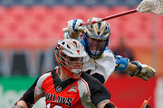 Noah Molnar #12 of Denver Outlaws controls the ball against Kevin Drew #19 of Charlotte Hounds at Sports Authority Field at Mile High on May 3, 2015 in Denver, Colorado. The Outlaws defeated the Hounds 15-12.