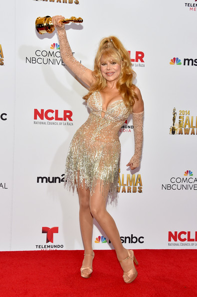 Charo Honoree Charo poses with the Ricardo Montalban Award for Lifetime Achievement at the Winner's Walk during the 2014 NCLR ALMA Awards at the Pasadena Civic Auditorium on October 10, 2014 in Pasadena, California.