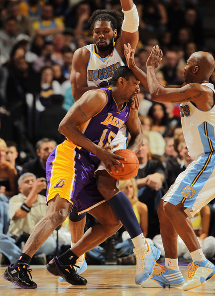 Los Angeles Lakers v Denver Nuggets [photograph,sports,basketball player,team sport,ball game,basketball moves,basketball court,player,basketball,tournament,sport venue,ron artest,user,defense,ball,nene 31,denver,pepsi center,denver nuggets,los angeles lakers]