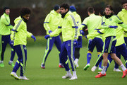 (l-r) Willian, Diego Costa and Filipe Luis of Chelsea in action during a Chelsea training session ahead of the UEFA Champions League round of 16 match against Paris Saint-Germain at Cobham Training Centre on February 16, 2015 in London, United Kingdom.