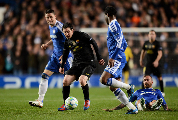 Lionel Messi of Barcelona takes on Mikel of Chelsea during the UEFA Champions League Semi Final first leg match between Chelsea and Barcelona at Stamford Bridge on April 18, 2012 in London, England.