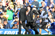 Jose Mourinho, Manager of Manchester United holds up three fingers to the Chelsea fans following the Premier League match between Chelsea FC and Manchester United at Stamford Bridge on October 20, 2018 in London, United Kingdom.
