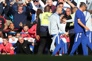 Jose Mourinho, Manager of Manchester United gets up to confront a memebr of the Chelsea backroom staff who celebrated Chelsea second goal of the game infront of him during the Premier League match between Chelsea FC and Manchester United at Stamford Bridge on October 20, 2018 in London, United Kingdom.