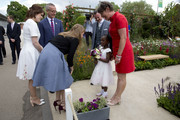 Princess Eugenie and Princess Beatrice meet 6 yr old Tavesha Steele from Brixton in the RHS Greening Grey Britain Garden by Anne-Marie Powell as they attend the Chelsea Flower Show press day at Royal Hospital Chelsea on May 23, 2016 in London, England. The show, which has run annually since 1913 in the grounds of the Royal Hospital Chelsea, is open to the public from 24-28 May.