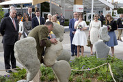 Prince Andrew, Duke of York (L), Princess Beatrice (R), Princess Eugenie (3rd-R) and Jack Brooksbank (4th-L) visits the stand of Adrian Gray Stonebalancing as they attend the Chelsea Flower Show press day at Royal Hospital Chelsea on May 23, 2016 in London, England. The show, which has run annually since 1913 in the grounds of the Royal Hospital Chelsea, is open to the public from 24-28 May.