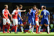 Diego Costa of Chelsea speaks to referee Mike Dean during the Barclays Premier League match between Chelsea and Arsenal at Stamford Bridge on September 19, 2015 in London, United Kingdom.