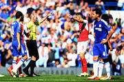 Gabriel of Arsenal is shown a red card bu referee Mike Dean during the Barclays Premier League match between Chelsea and Arsenal at Stamford Bridge on September 19, 2015 in London, United Kingdom.