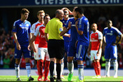 Referee Mike Dean talks with Diego Costa of Chelsea during the Barclays Premier League match between Chelsea and Arsenal at Stamford Bridge on September 19, 2015 in London, United Kingdom.